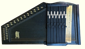 Type 'A' Oscar Schmidt autoharp, also known as 'Model 73.'  See how much room there is 'south' of the chord bars for strumming?  It's made for playing in your lap, not in an upright position like later autoharps.  Click for bigger photo.