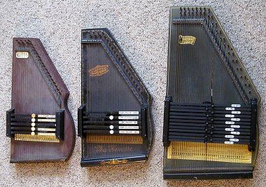 Three early Autoharp designs. The first two were based on early Zimmerman designs, the third rose to prominence after Oscar Schmidt bought the right to build autoharps from a previous owner.  Click for bigger photo.