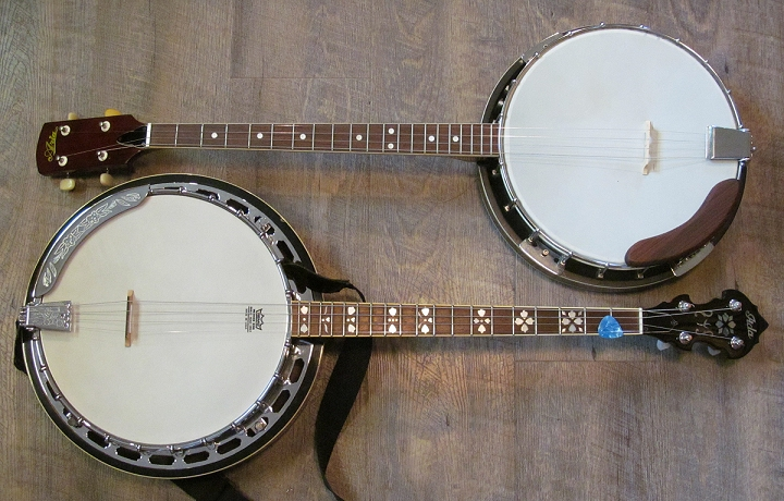Two very different Aria four-string banjos.  The first one is nearly a clone of contemporary early 1950s Harmony banjos.  The second one shows some better features and some original engineering, which places it ahead of most under-$400 Asia banjos today, though it still looks like a more professional banjo than it really is.  Either can be tuned to Jazz or Irish tuning, if you buy the right strings.  Click for a 'blow-up.'