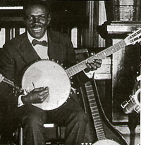 Johnny St. Cir, who used a 6-string banjo to play bass lines in King Oliver's Creole Jazz Band.