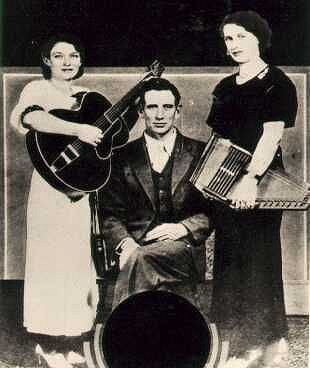The Carter Family several years before their first recording.  Sarah may be holding the 7-chord Model 72 7/8 that is now on display at the Country Music Hall of Fame and Museum. Sorry, I don't have a bigger photo.