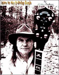Mickey Cochran holding one of his favorite banjos, from the back cover of one of his DVD lesson packages.